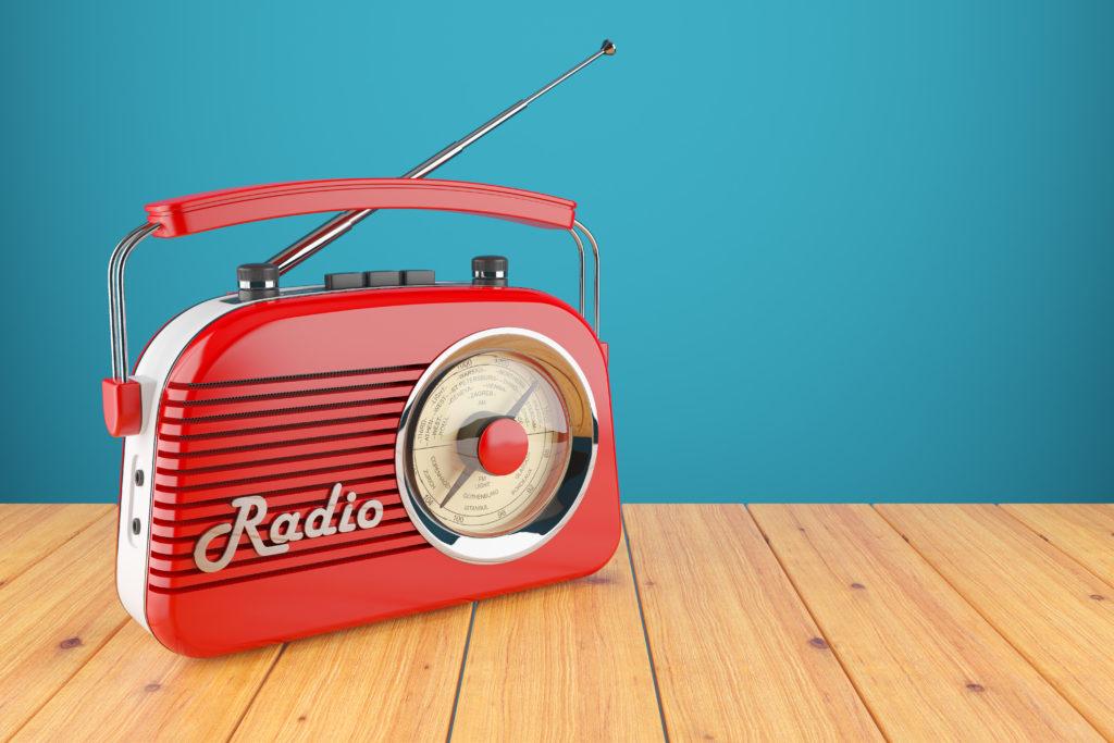 Vintage red radio receiver on wood table